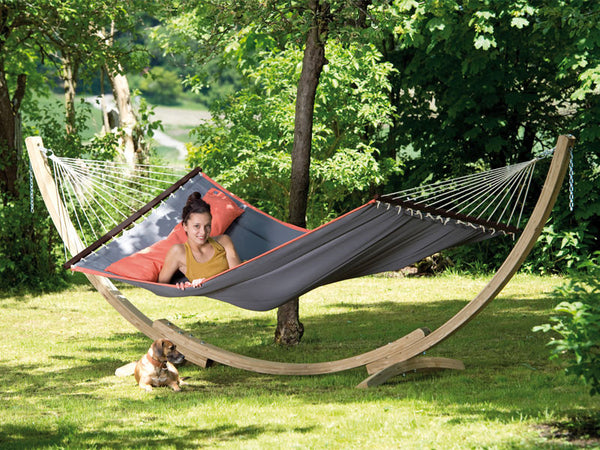 Woman reclining in grey American Dream hammock with stand set