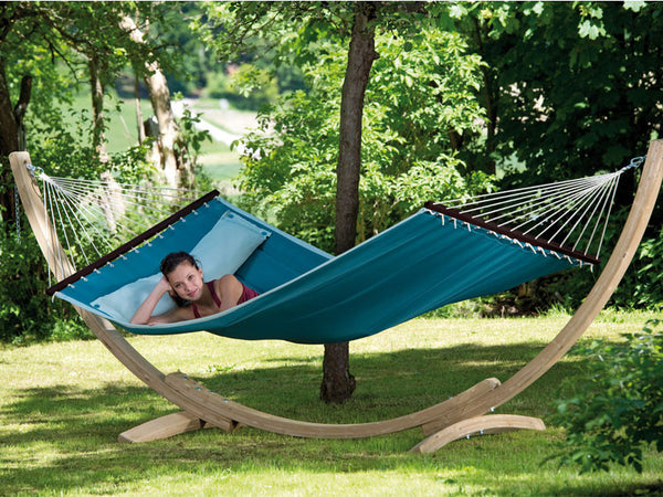 Woman reclining in petrol blue American Dream hammock with stand set
