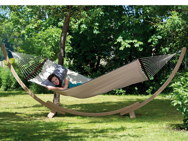 Woman reclining in sand American Dream hammock with stand set