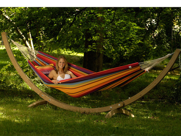 Girl lying in tropical striped Barbados hammock with stand set