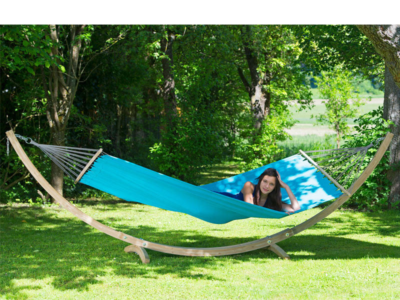 Woman lying in Aqua blue Miami hammock with wooden stand