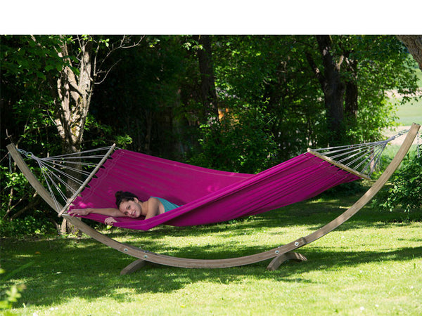 Woman lying in Berry purple Miami hammock with wooden stand