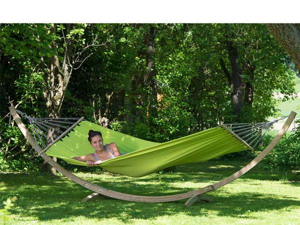 Woman lying in Kiwi green Miami hammock with wooden stand