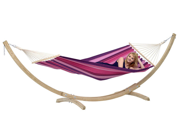 Girl propped in Tonga hammock in Candy pink stripes with a wooden stand