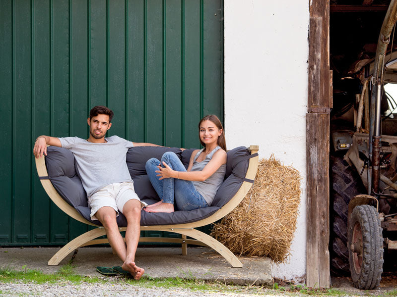 Couple sat on Siena Due Sofa in Anthracite