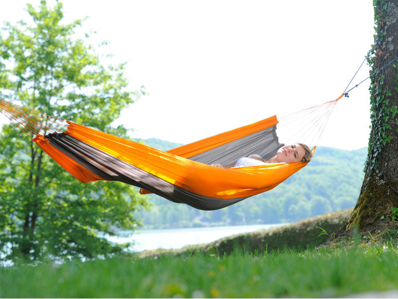 Woman in Silk Traveller Hammock Techno Orange Grey by lake