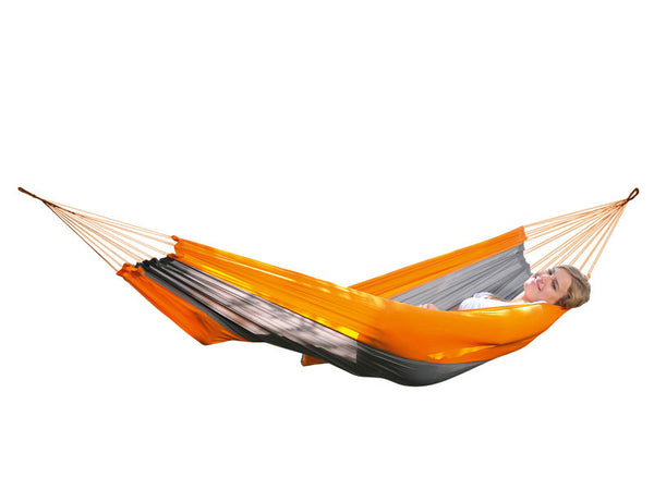 Woman lying in Silk Traveller Hammock Techno Orange Grey.