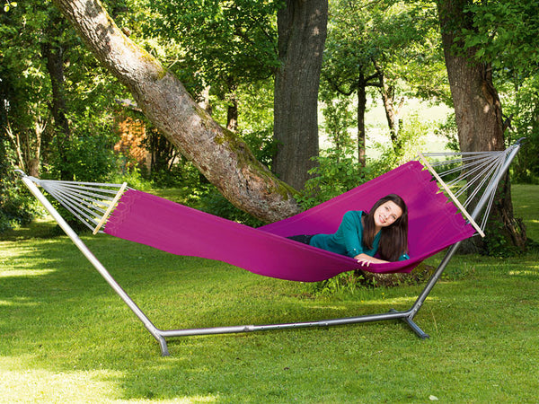 Woman lying in hammock supported by Sumo Rockstone Hammock Stand.