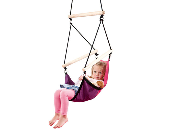 Young girl sat in Kid's Swinger Pink Child's Hanging Chair with white background.