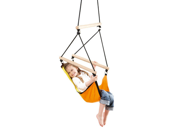 Girl sat in Kid's Swinger Green Child's Hanging Chair with white background.