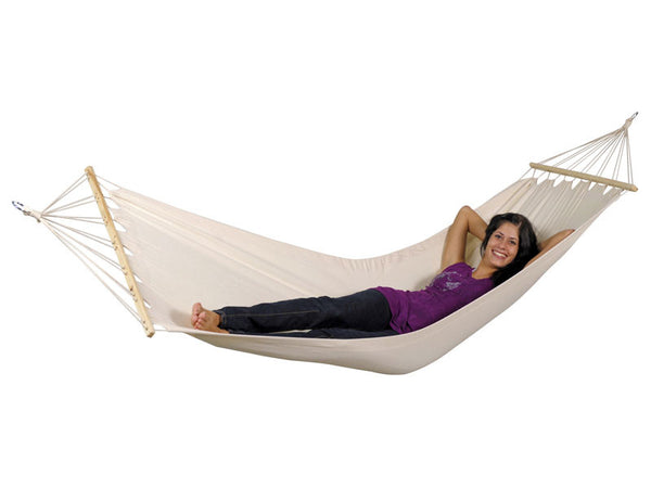 Girl lying in white Tobago hammock with spreader bar