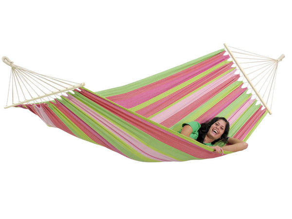 Girl relaxing in pinks and greens striped Tahiti Bubblegum hammock with spreader bar