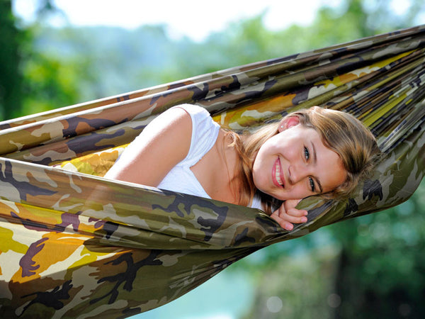 Close up of woman lying in camouflage Travel Set hammock.