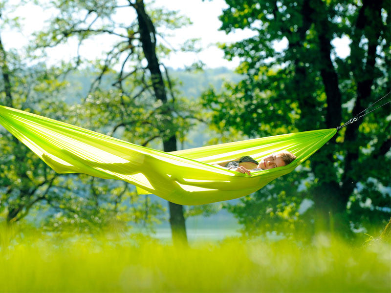 Woman lying in lime Travel Set hammock.