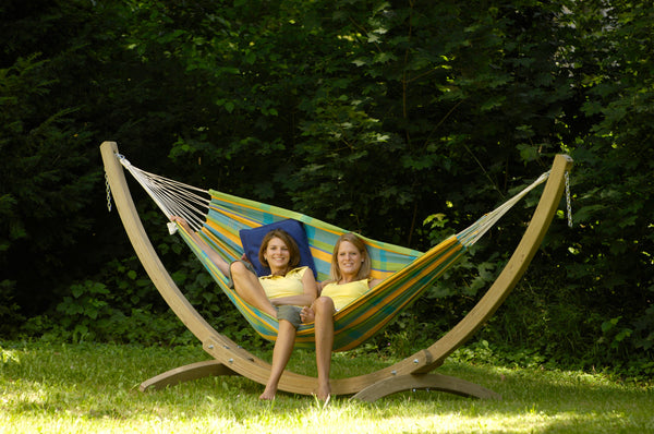 Two women sat in hammock supported by Troja Hammock Stand