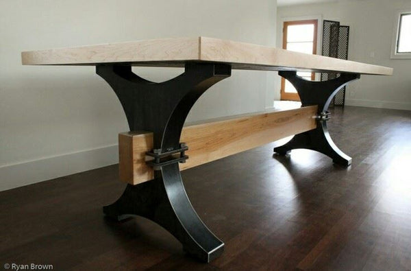 Searching Pinterest reveals incredible furniture such as these tables built by fabricators that are examples of incredible wood work and metal work.
