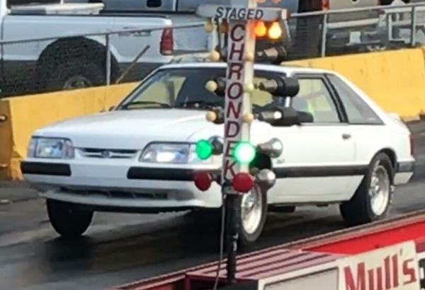 BJ Adams' 1990 Mustang LX Hatch Coyote Swap, 10 second 1/4 mile, 10 hole wheels, red interior, TKO, full suspension, home brewed, boat towing monster.