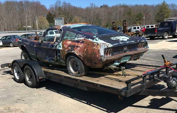 Saving two 1967 vintage mustangs by combining a parts car coupe with a rotten fastback by grafting and fabricating the fastback roof and interior structures onto the coupe chassis to make one good car out of two cars destined for the junk yard.