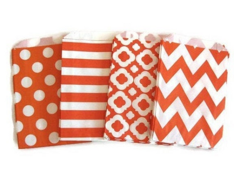orange and white party favor bags