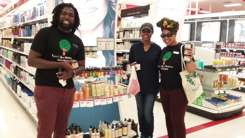Kyra, John and customer at Target with products on shelf