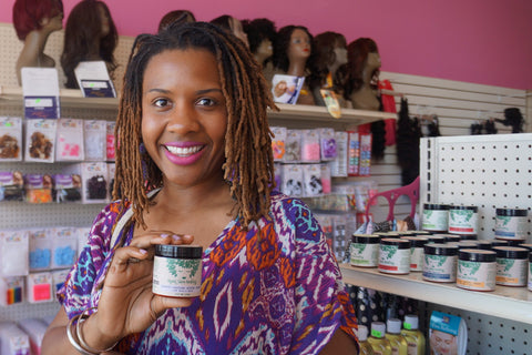 Woman holding Growth + Restore Butter Cream at Girl Cave LA Beauty Supply in Los Angeles