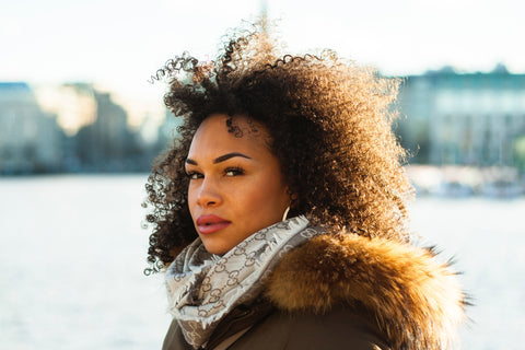 Natural hair with curls in fall season