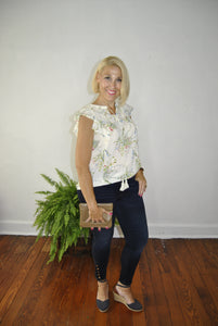 white floral sleeveless top
