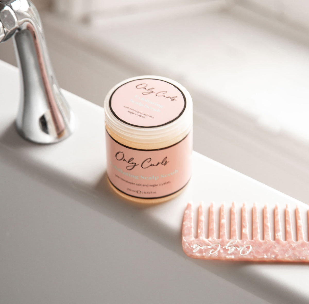 Exfoliating Scalp Scrub in the bath with comb by Only Curls