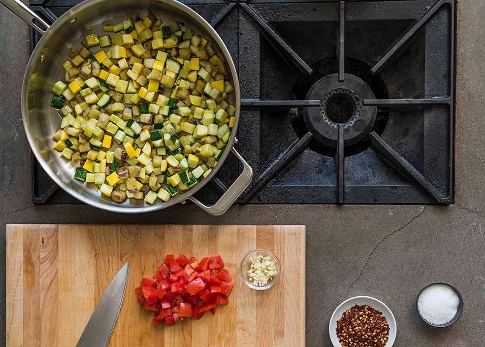 Cast iron vs. stainless steel: diced vegetables in a stainless steel saute pan