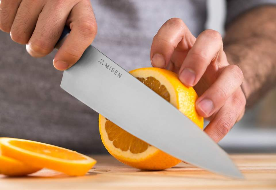 Best steel for knives: the Misen chef's knife slices an orange