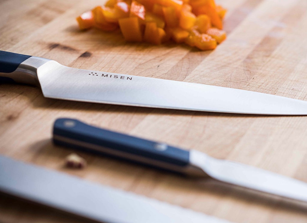 Chef knives: three knives on a cutting board