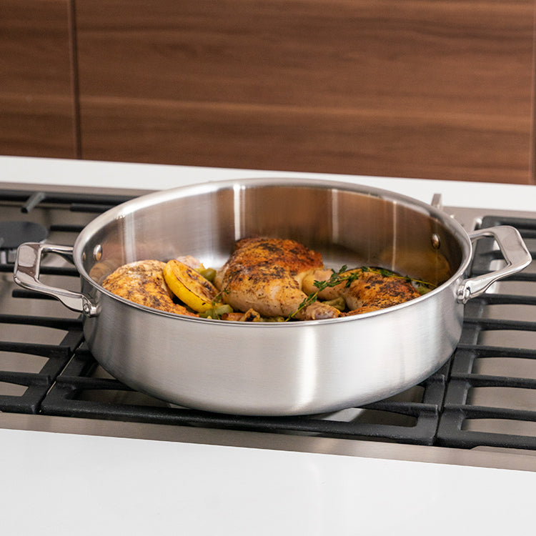 The Misen Rondeau is light and shallow, with a wider cooking surface.