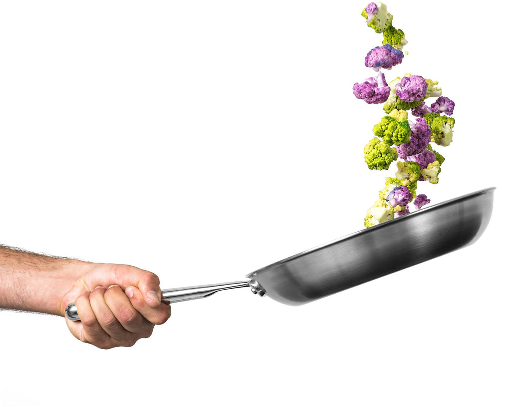 How to Sauté: Vegetables being tossed and cooked