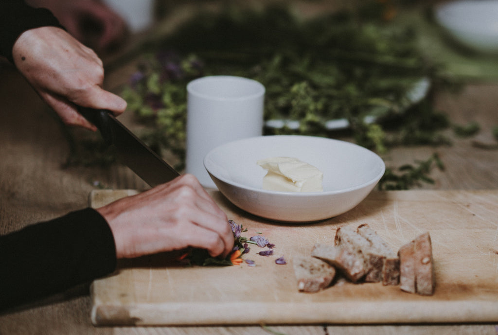 Best knives: A woman slices herbs and aromatics with a chef's knife