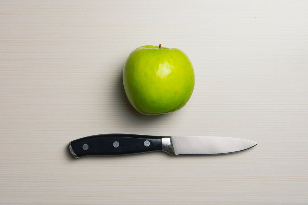 Knife tang: an apple and a full-tang paring knife