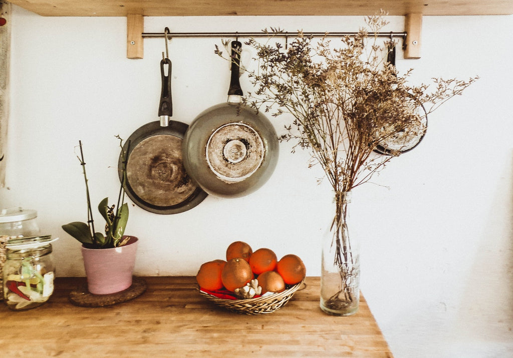 Nonstick cookware: old skillets hanging on a kitchen wall