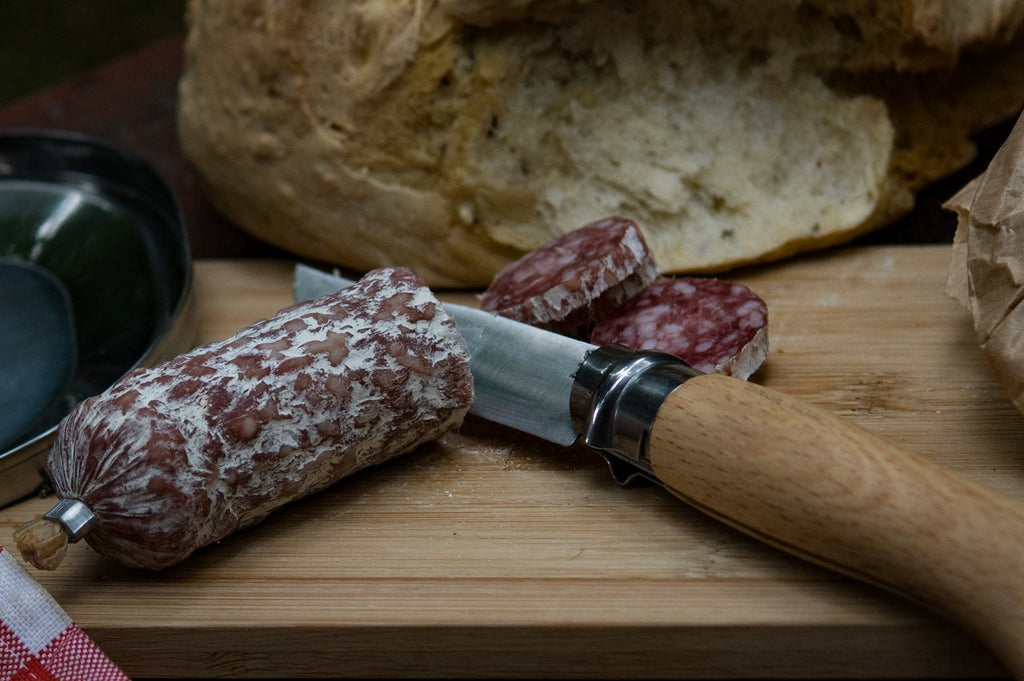 German knives: a paring knife and salami