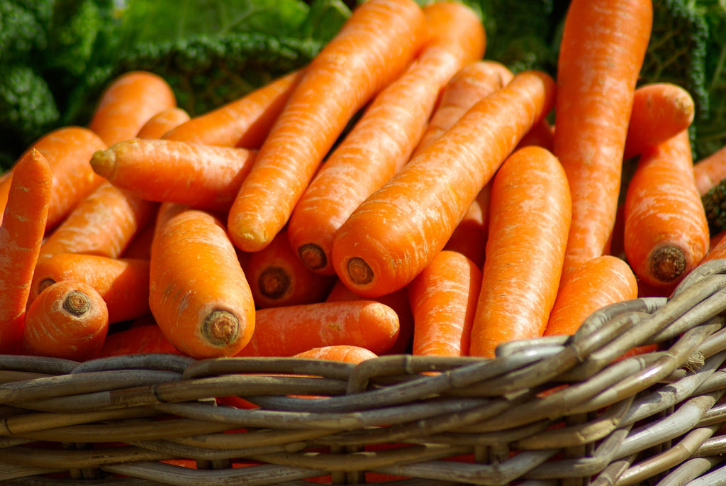 A basket of carrots ready to be batonnet cut