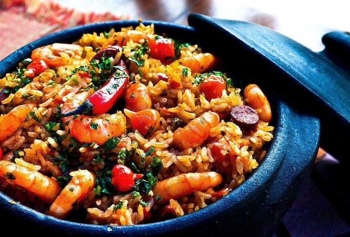 Types of pans: a blue enamel dutch oven full of paella