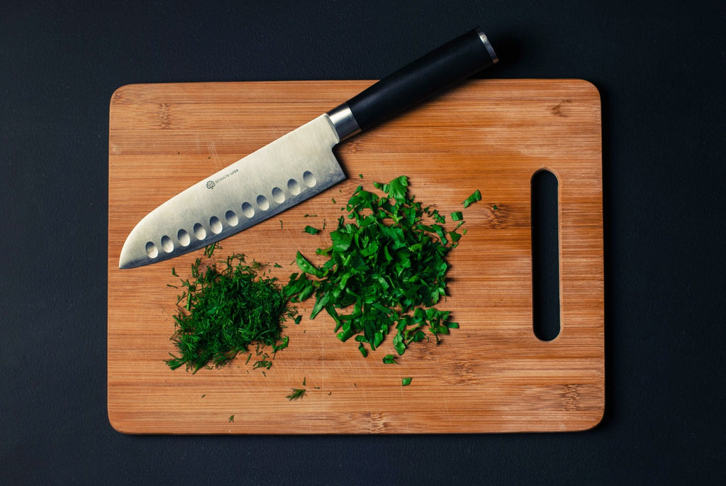 Best wood for cutting board: minced herbs on a cutting board