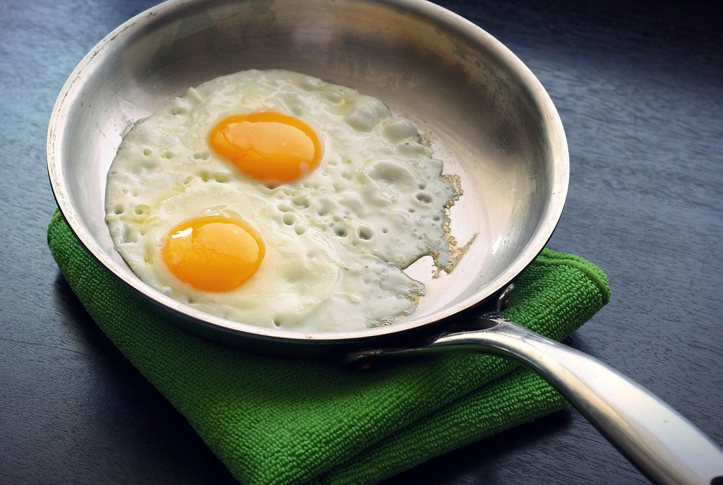 Skillet cooking: fried eggs in a stainless steel skillet