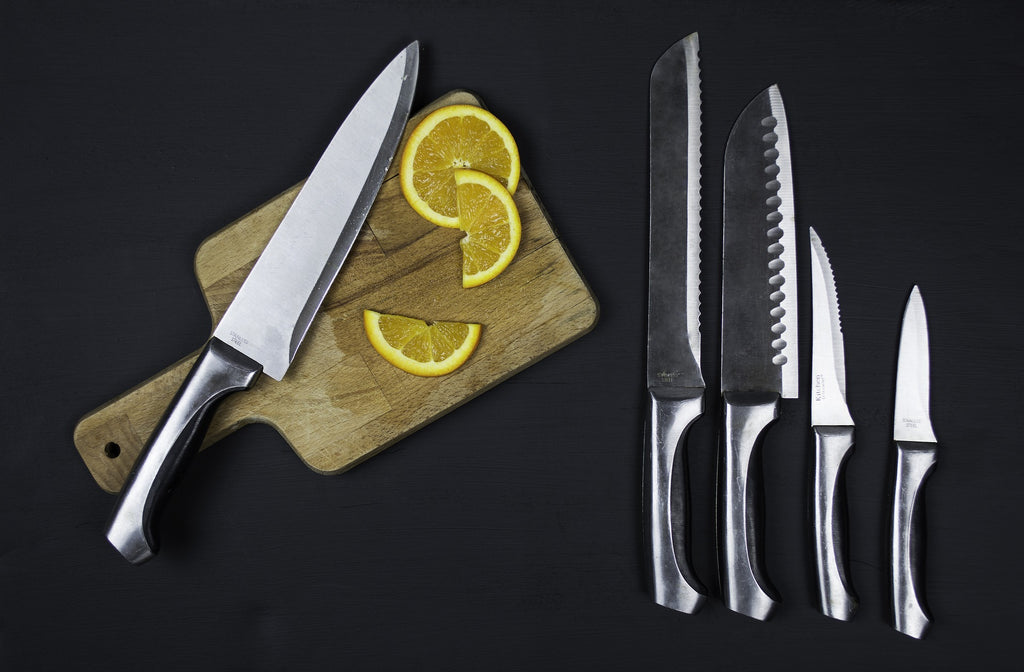 Kitchen knives: a set of kitchen knives and a cutting board