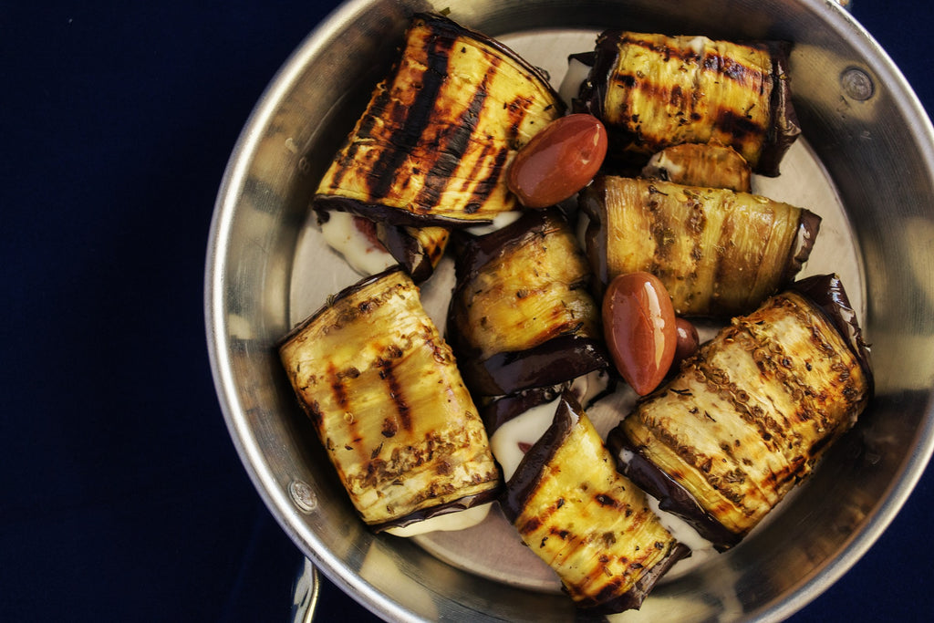 How to cut eggplant: Eggplant planks roasting in a stainless steel pan