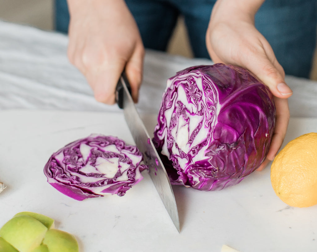 Best Knives: A santoku knife slices cabbage