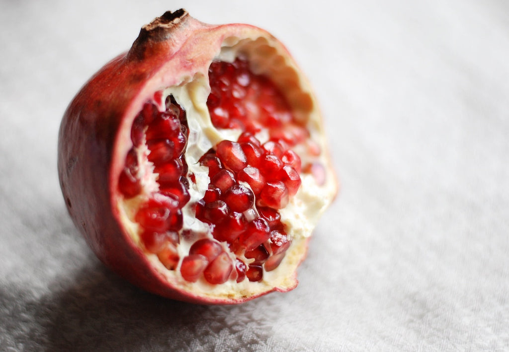 How to cut a pomegranate: a section of a pomegranate ready to be deseeded