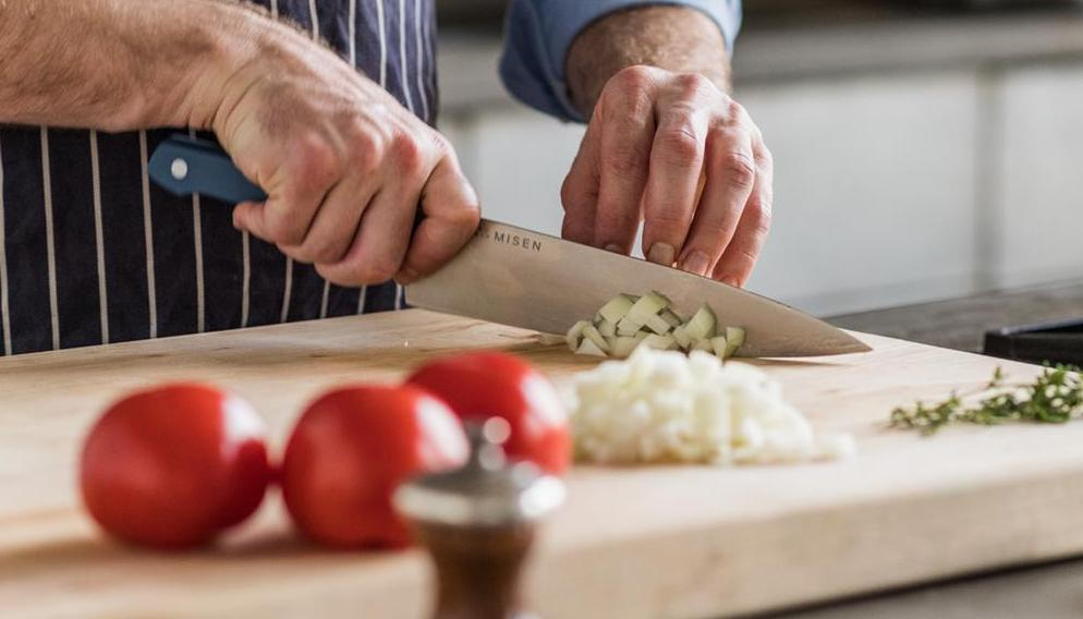 Chef knives: A man slices vegetables with a chef knife