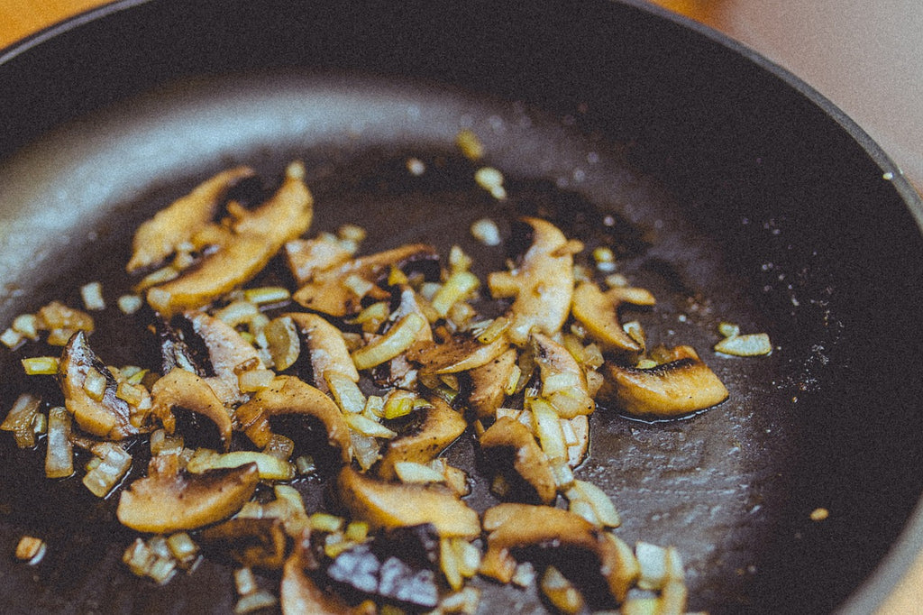 Ceramic vs. Teflon: Closeup on mushrooms in a Teflon pan