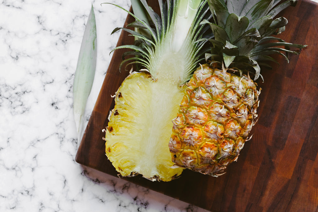 Best wood for cutting board: a pineapple on a dark wood cutting board