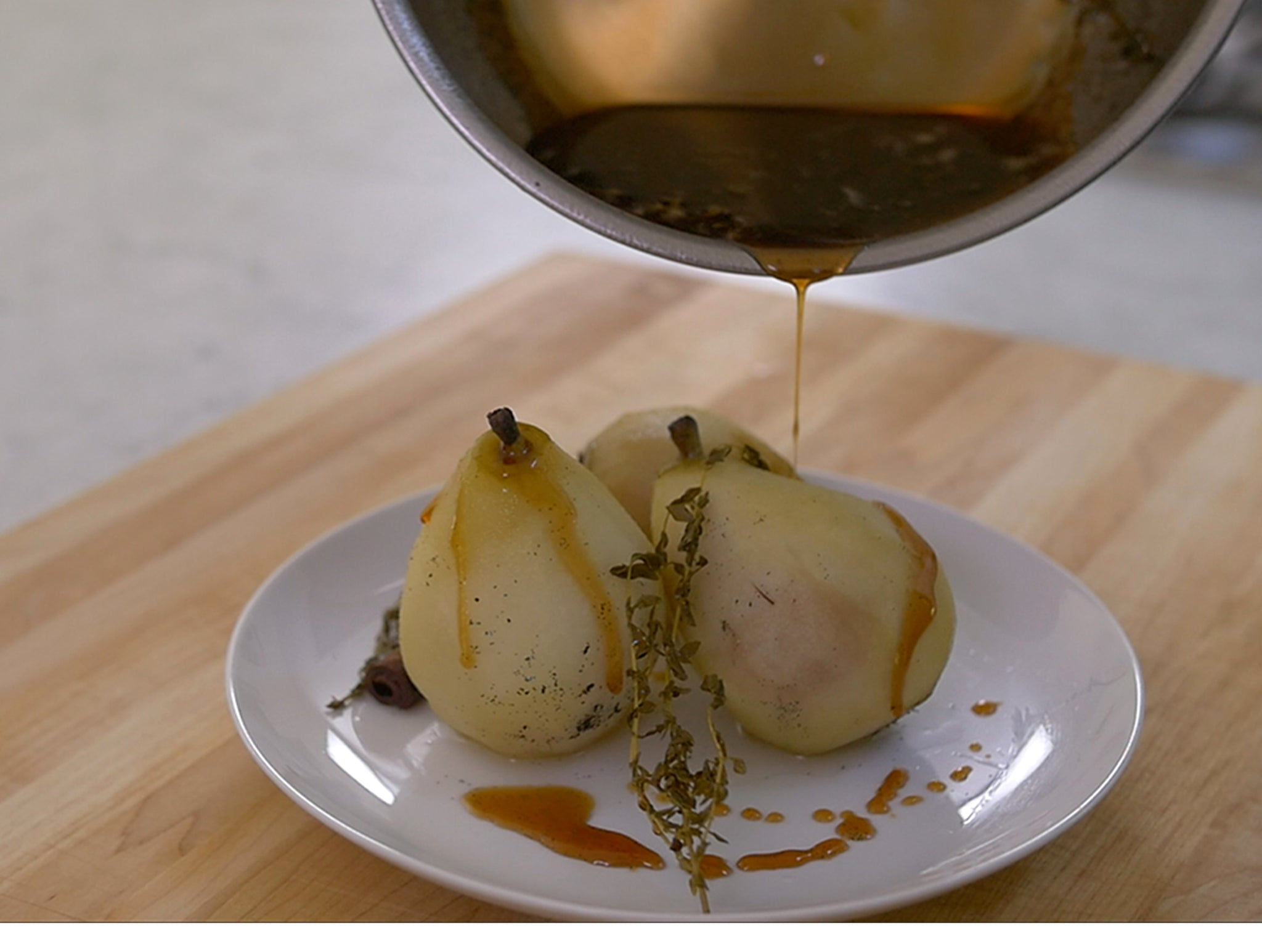 Pouring caramel sauce onto poached pears is less messy with the Misen Saucier, which features a dripless pouring edge.