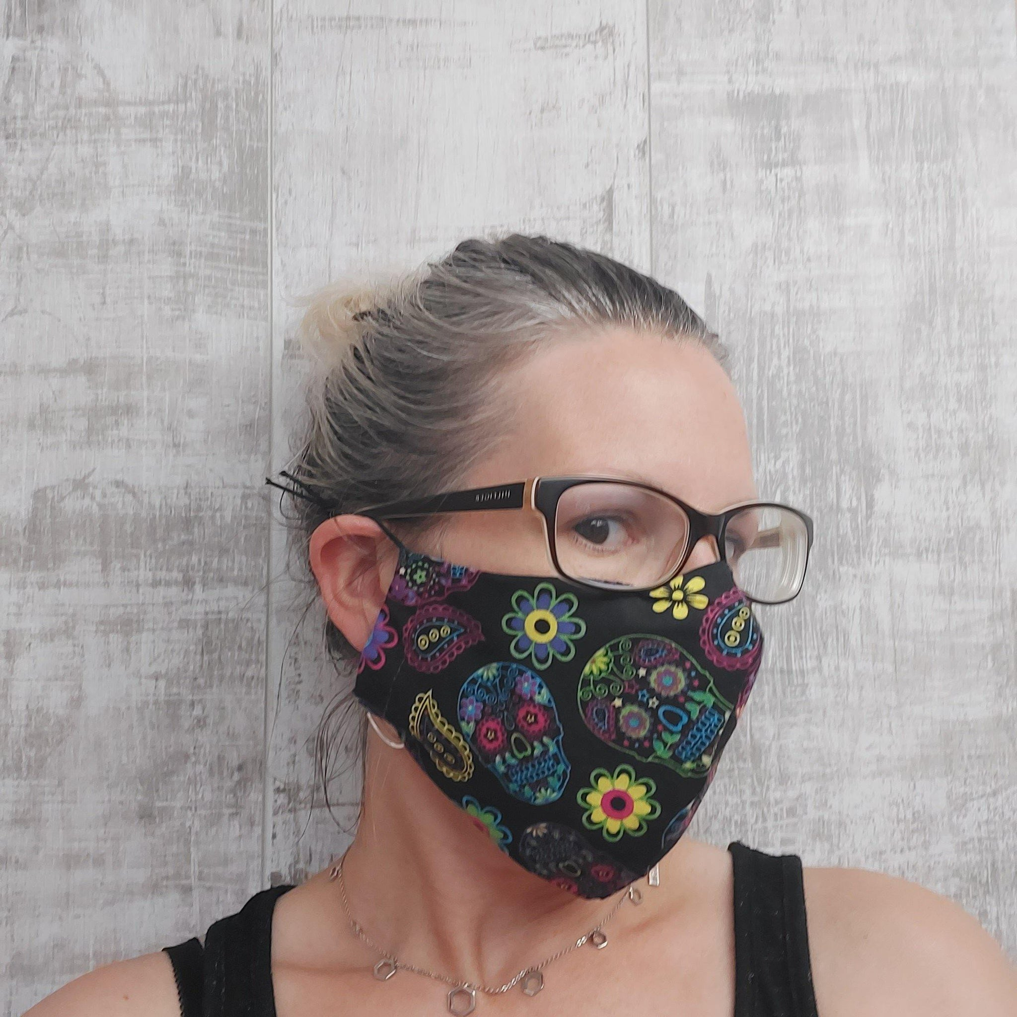Face mask with sugar skulls print.
